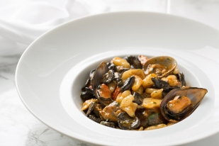 Cavatelli, cozze e vongole (Homemade white and black cavatelli pasta, clams, mussels, cherry tomatoes)